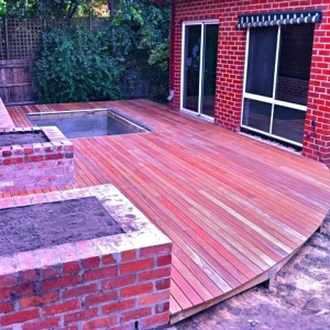 ST KILDA - Rear hardwood deck with rounded edge and inground trampoline cut-out.