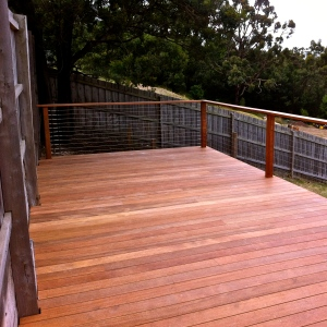 PAKENHAM - Raised Merbau deck with matching handrail, stairs and wire balustrade.