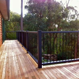 KALORAMA - Cypress deck renovation with custom vertical balustrade.